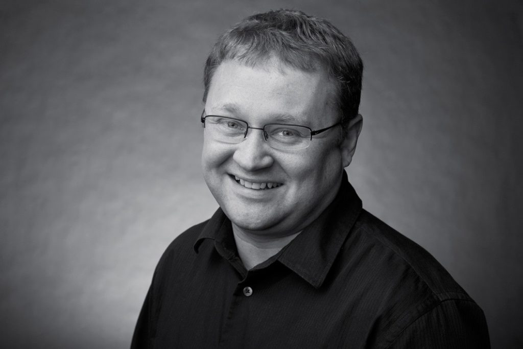 Black and white photo of Andreas smiling